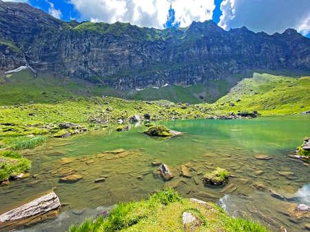 The alpine lake Blausee or Blue Lake in the Uri Alps mountain massif, Melchtal - Canton of Obwalden, Switzerland (Kanton Obwald, Schweiz)
