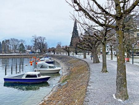Promenade and park with trees along the shores of Swiss Lake Walenstadt (Walensee), Weesen - Canton of St. Gallen, Switzerland (Kanton St. Gallen, Schweiz)