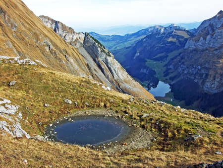 Small alpine lakes and watering places for cattle formed by melting glaciers in the Alpstein mountain range, Schwende - Canton of Appenzell Innerrhoden (AI), Switzerland (Schweiz)