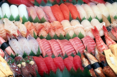 An assortment of many kinds of sushi