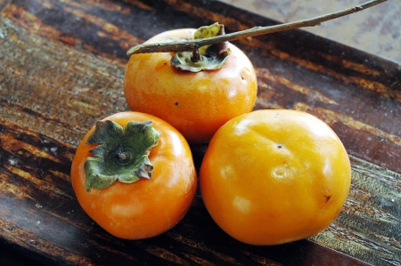 A persimmon with the branch which was able to be taken in the yard of the house