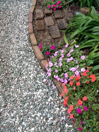 A flower bed and a gravel road