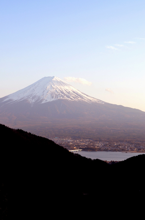 Three Mt. Fuji and Lake Kawaguchi from the pass in the mountains.