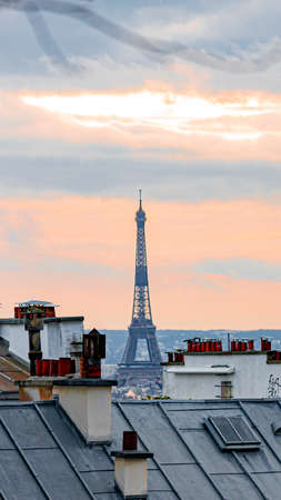 Roofs and penthouses typical of paris, with the historic tiles and chimneys