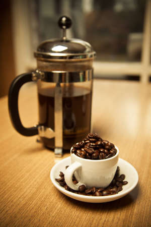 french bean: Small Cup of Coffee Beans and French Press