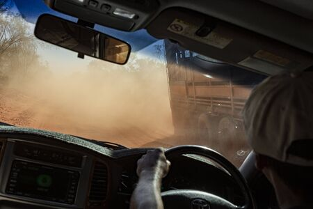 driving in the Australian outback on a dusty road