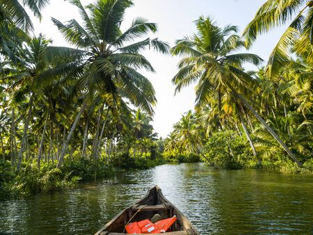 river cruise in the Kerala backwaters with traditional wooden fisherman boat 写真素材