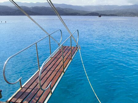long wooden swim platform with a reeling and ship waves beyond Banco de Imagens