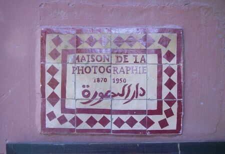 Marrakesh, Maroc_April 02,2010:sign for the museum of Photographie in Marrakech made of tiles Redactioneel