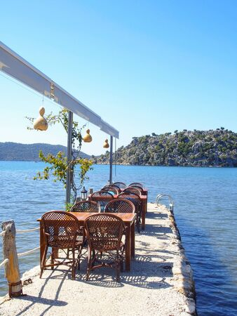 Kekova, Turkey-April 26, 2016:restaurant with wooden table and chair on a jetty in Demre, Turkey