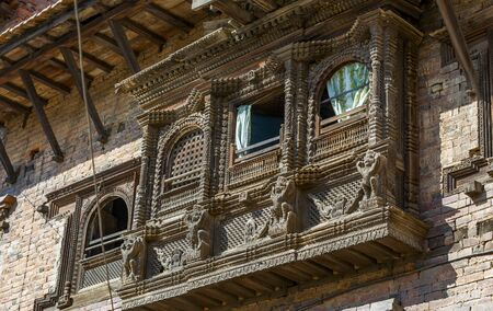 Kathmandu, Nepal_ November 03,2017:beautiful wooden carved balcony in Kirtipur in the Kathmandu valley