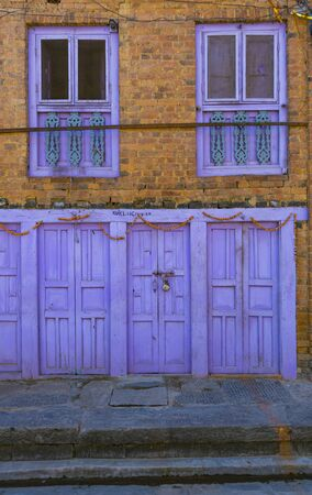 Kathmandu, Nepal_ November 03,2017:colorful house facade with wooden windows and doors in Kathmandu Editöryel