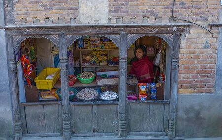 Kathmandu, Nepal: November 03,2017:young Nepali women selling food and house ware out of small  grocery store