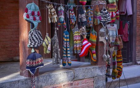 typical Nepalese knitted  caps and socks on a market stall in Kathmandu Editöryel