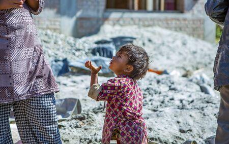 Kathmandu, Nepal-November 04,2017:begging little asian girl holding hands up