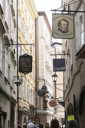 Salzburg, Austria-September 24,2017: street front with various store names  down town Salzburg city