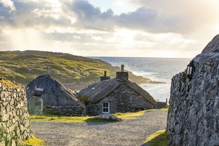 Gearrannan blackhouse village on Isle of Harris in a golden evening light Editöryel