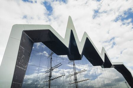 waterfront side of the RIVERSIDE MUSEUM WITH LIFEBELTS IN THE FOREGROUND