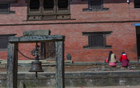 Kathmandu, Nepal_ November 03,2017:temple in Kirtipur in Kathmandu valley with a bell in the background