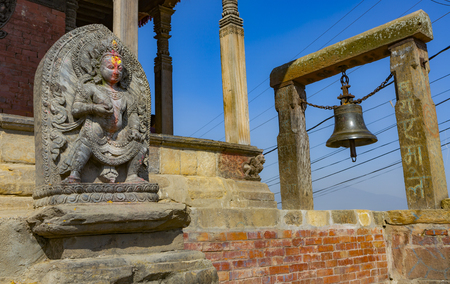 temple in Kirtipur in Kathmandu valley with a hindu divinity statue in the foreground 報道画像