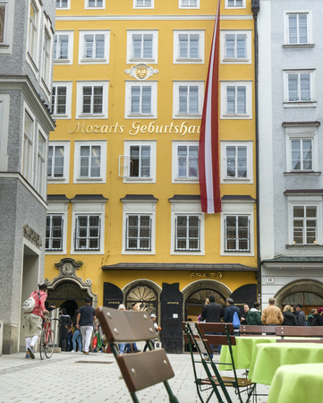 Salzburg, Austria-September 24,2017: birthplace of Wolfgang Amadeus Mozart down town Salzburg city and some tourist in the foregound