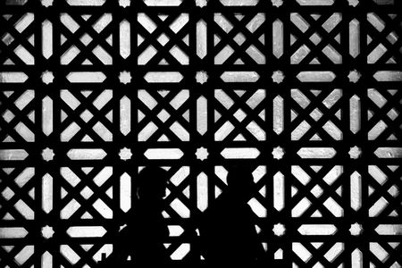 Black and white silhouette of people visiting Cordoba Mosque, Spain