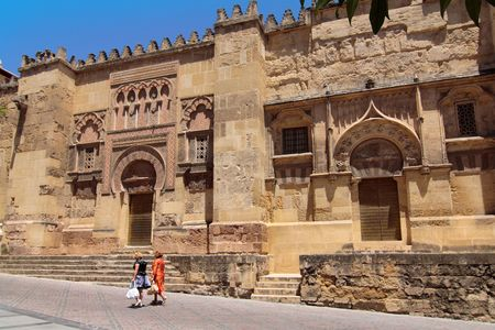 Women walking in front of the mosque, in Cordoba, Spain