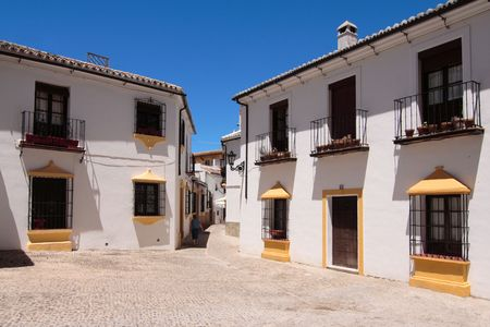 A street with cobblestones in Ronda, Andalusia, very typical and picturesque Stock Photo