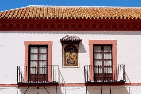 Typical front of a building and windows in Carmona, Andalusia