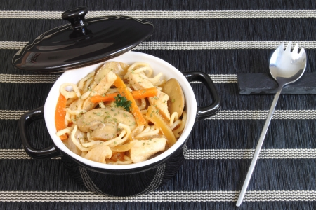 Casserole with noodles and chicken photo
