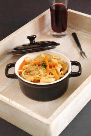Casserole with noodles, chicken and vegetables photo