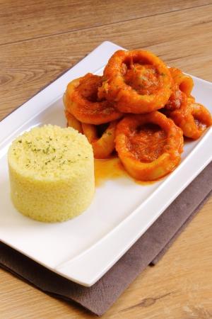 Calamari in tomato sauce with couscous Stockfoto