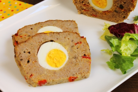 Meatloaf with boiled egg and red pepper photo