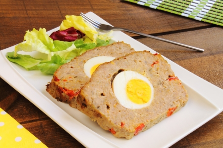 Meatloaf with boiled egg and red pepper Stockfoto