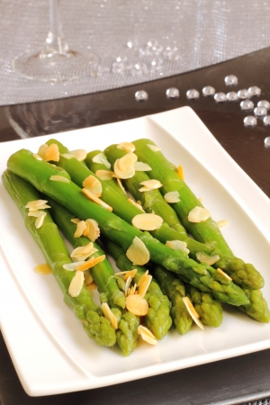 Roasted asparagus with almonds on a Christmas table photo