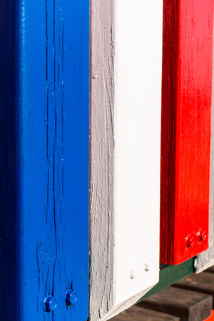palisade: palisade painted at the beach,french flag Stock Photo