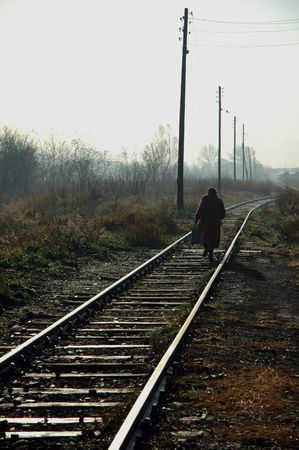 going down: An old woman going down the railroad