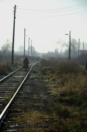 An old woman going down the railroad Stock Photo - 384473