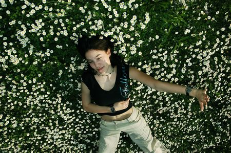 Girl in the flowers defending herself photo