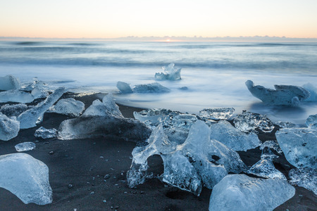 The Jokulsarlon glacier lagoon and ice beach Diamond Beach Jokulsarlon at sunrise in south iceland lagoon iceberg
