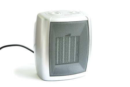 Small portable electric heater isolated on white background