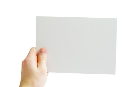Paper card in hand isolated on white background photo
