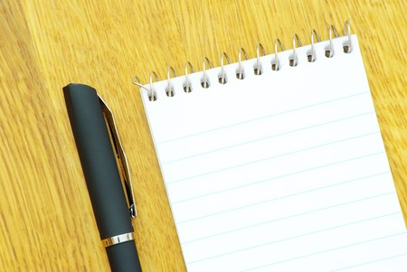 black pen and notebook in wood Stock Photo - 8009988