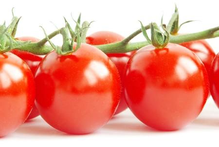 bunch of fresh cherry tomato on white background photo
