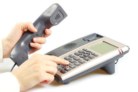 finger presses figure on a phone Stock Photo