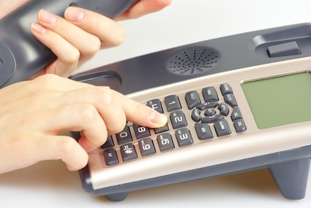 finger presses figure on a phone photo