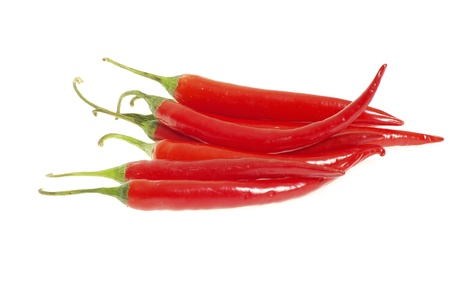 Red hot chili peppers on white background photo