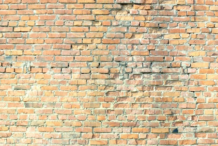 Grunge orange brick wall background texture photo