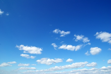 scenic background: clouds in the blue sky