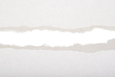 Loch in das Papier mit zerrissenen Seiten Standard-Bild - 10580610